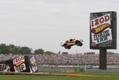 """Today as part of """"IZOD Presents Hot Wheels Fearless at the 500™,"""" Team Hot Wheels™ Yellow Driver Tanner Foust successfully landed a ramp-to-ramp distance jump of 332 feet. Foust, a..."""